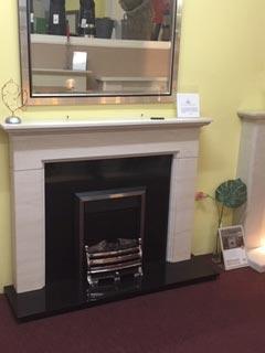 Limestone Mantle, Granite backpanel & hearth with electric fire